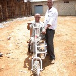 A man disabled by Polio who lives in Ethiopia, was found along the road by a Soddo Christian Hospital worker and was brought to the hospital to get a trike.